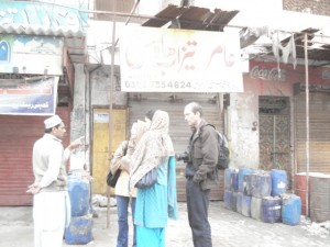 The same team talking to an acid retailer in Multan, Punjab.